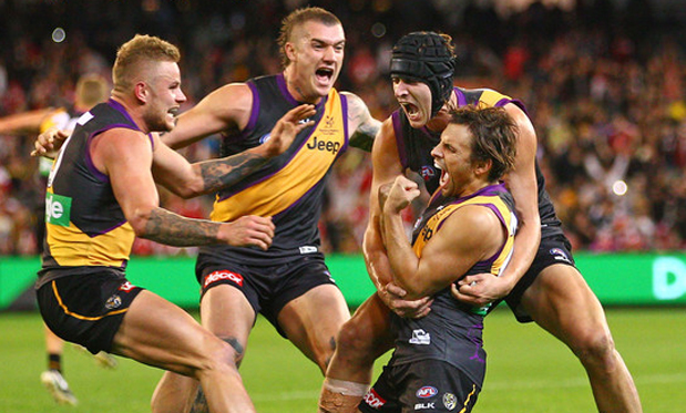 Teammates mob Sam Lloyd after his match-winning goal against Sydney. Image: Scott Barbour/AFL Media/Getty Images AsiaPac