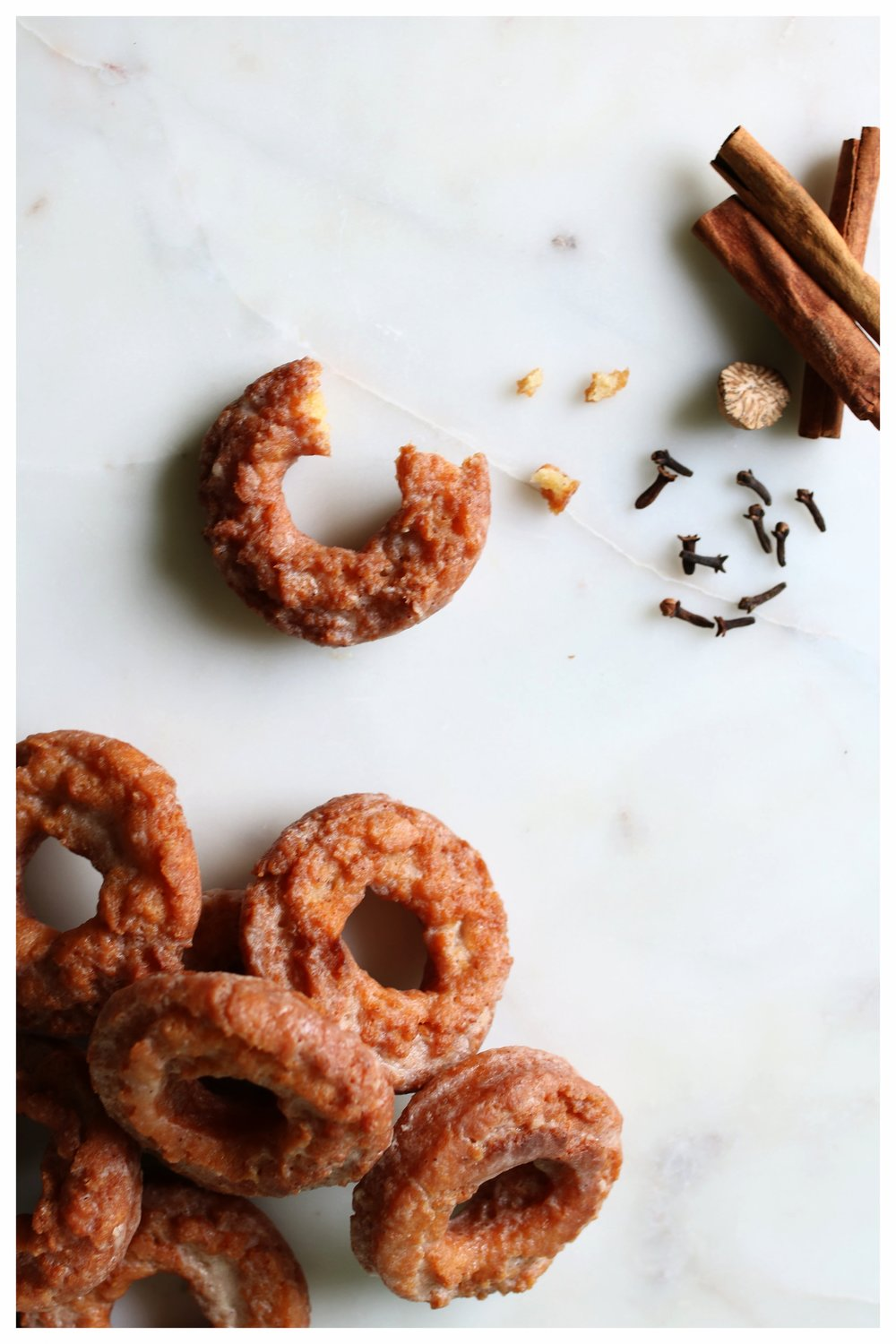 Pumpkin Spice Sour Cream Glazed Doughnuts