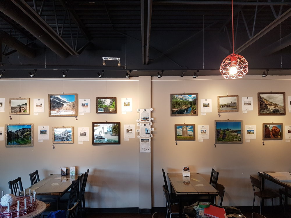 Wide view of the public exhibit in the Common Ground Community Cafe in Sherwood Park, Alberta, Canada.