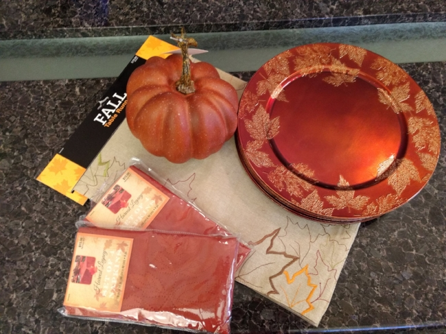 A fall runner, fall napkins, a pumpkin and fall chargers--hope you win.