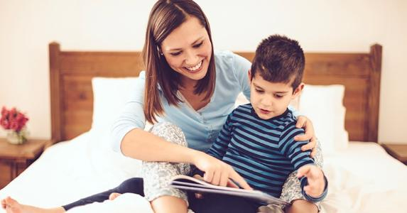 young-mom-reading-bedtime-story-to-son_573x300.jpg