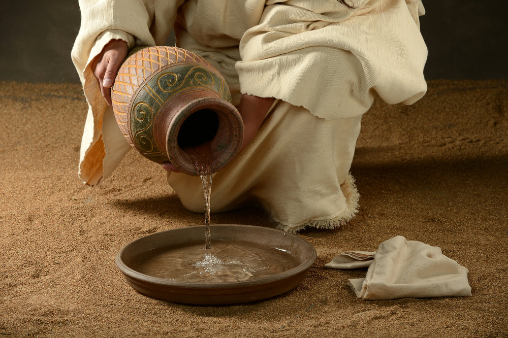 jesus pouring water model for motherhood.jpg
