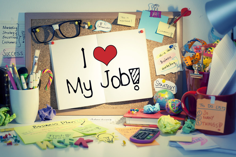 "Cork Board with Note saying ""I Love my Job"""