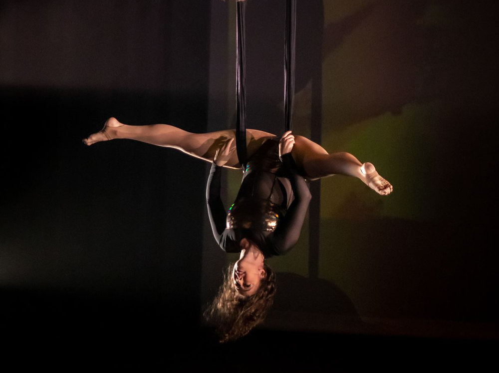 Danielle Garcia  A former gymnast and gymnastics instructor with insane flexibility and killer split roll throughs, Danielle easily took to the air. She has years of stage experience having danced Latin and Swing in numerous local stage productions.