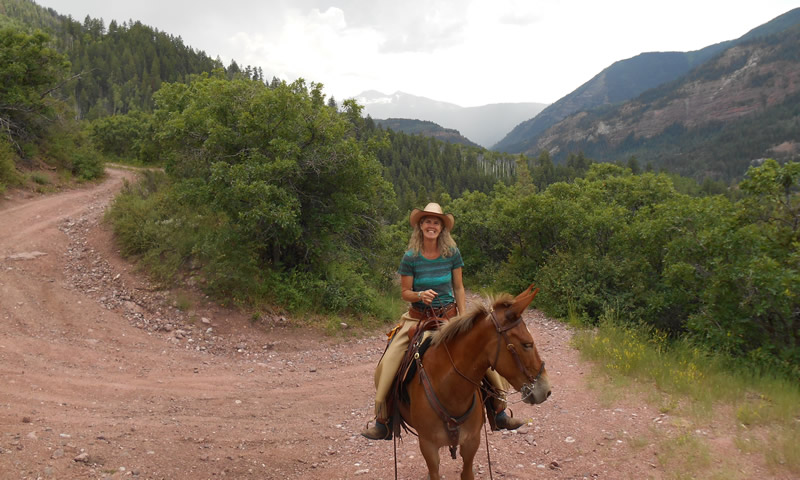 Suzanne in the mountains on horseback