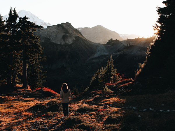 woman looking at the mountains