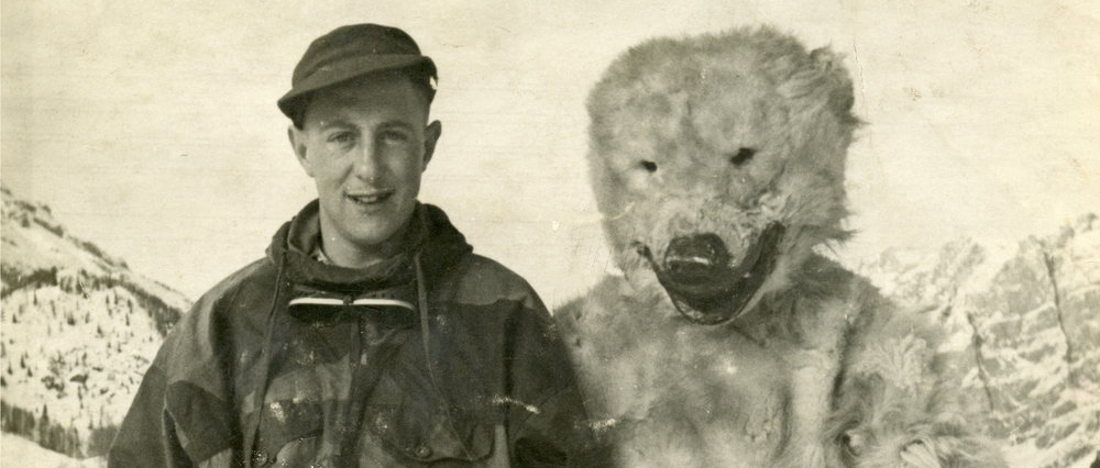 Ernest Chadwick with unnamed man in bear costume in the Italian Alps during World World II.