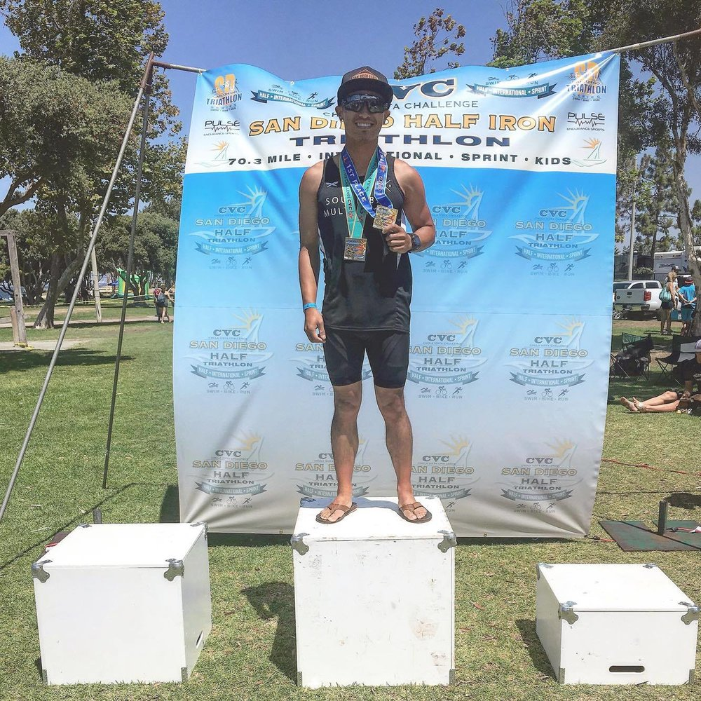 "SBMS Athlete Andrew Rioveros, pictured above after taking 1st place in the 20-24 Age Group at the Chula Vista Challenge Sprint Triathlon. Trained by Coach Zack.  ""South Bay Multi Sport has brought me up to new levels of accomplishments in the sport of triathlon. The coaches know exactly what it takes for each individual athlete to reach their full potential. Under the coaching of Zack hammer, I was able to PR and place top ten in my age group for the 2016 Mission Bay Triathlon for the first time since 2012. Furthermore, I placed 1st in my age group at the 2016 Chula Vista Challenge Sprint Triathlon which qualified me for the Age Group National Championships. My favorite part about being in this family of athletes is the encouragement and motivation you get on and off season. Coach Zack and Coach Josh work hard to see their athletes take on PR's and podiums."""