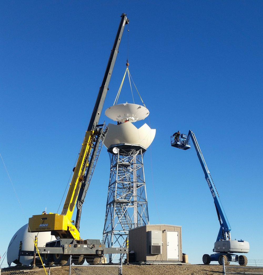 HGC and a crane subcontractor putting the finishing touches on a radar tower; Ft. Greely, Alaska