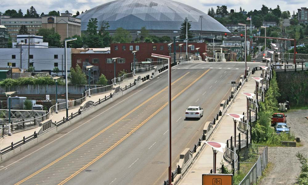 EAST D STREET GRADE SEPARATION , Tacoma, Washington  Owner/Client : City of Tacoma  Services : Civil and Structural Engineering, Environmental Permitting, Construction Management ACEC's Engineering Excellence 2009 Silver Award for Transportation