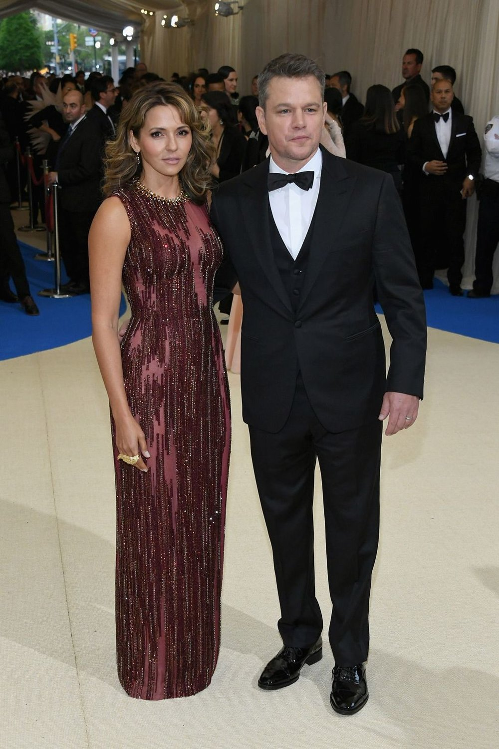 Matt Damon, in a three piece  Versace  tuxedo, with his wife Luciana Barosso, in an  Atelier Versace  gown