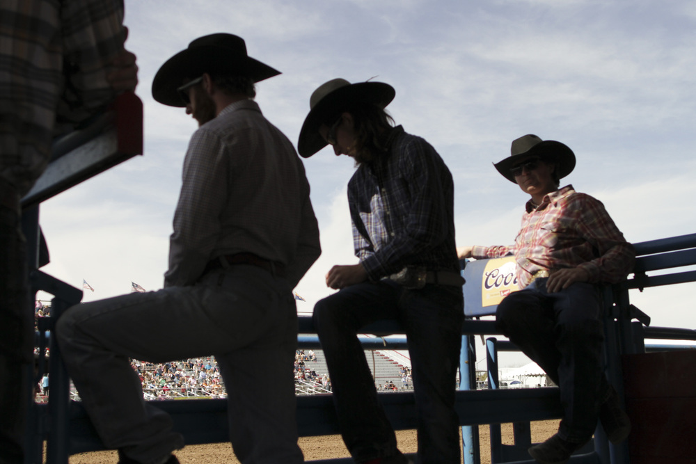 Cowboys watch the Fiesta de Los Vaqueros in Tucson, Arizona in February 2014.