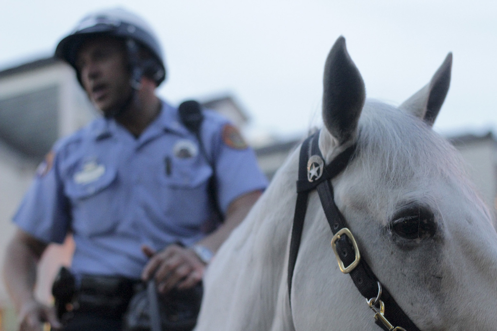 Officer Patrick Schneider patrols Bourbon Street in New Orleans, Louisiana on his horse, Cody, on May 27, 2014.