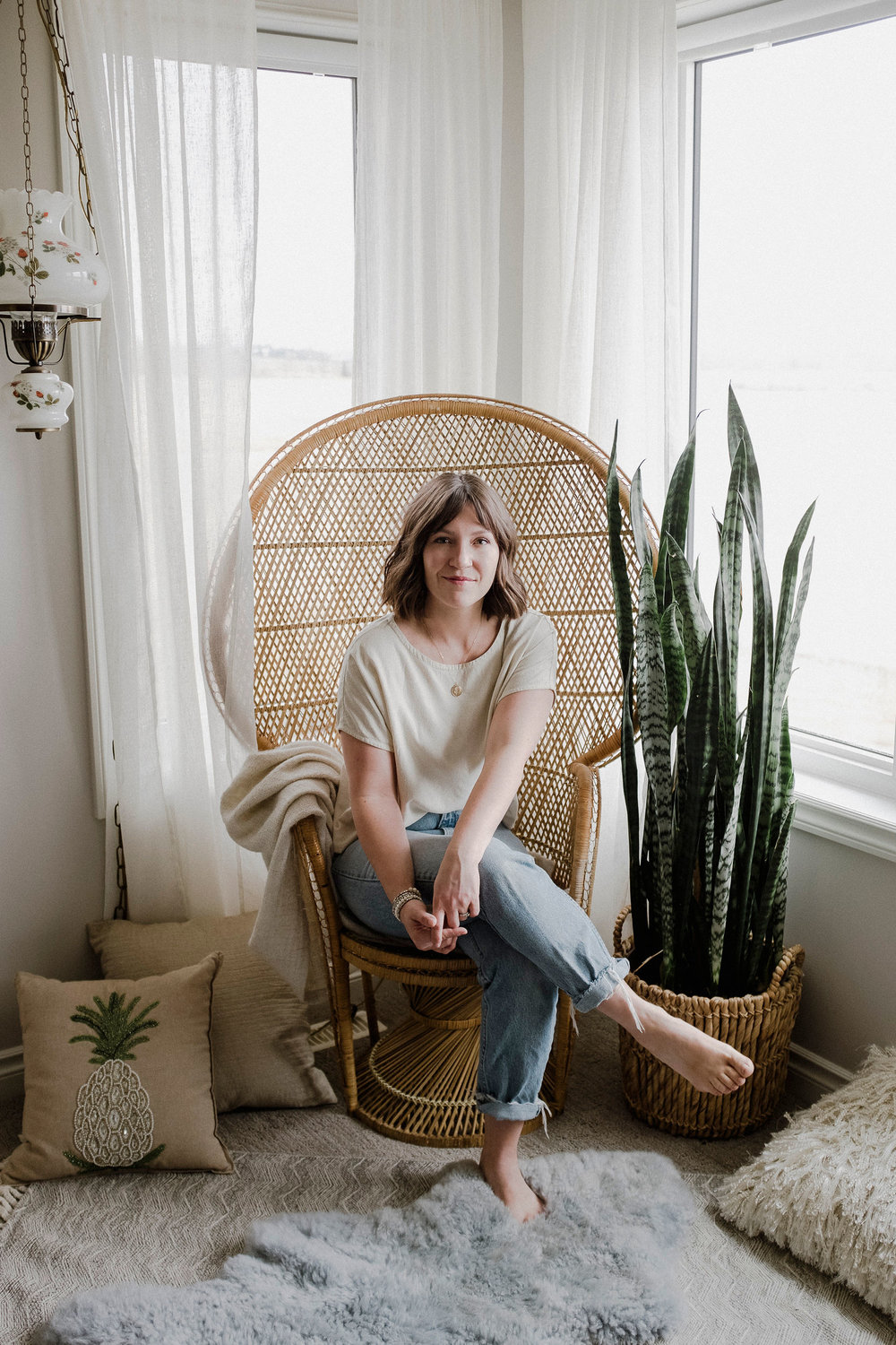 Karmen Meyer  at home with her Snake Plant.