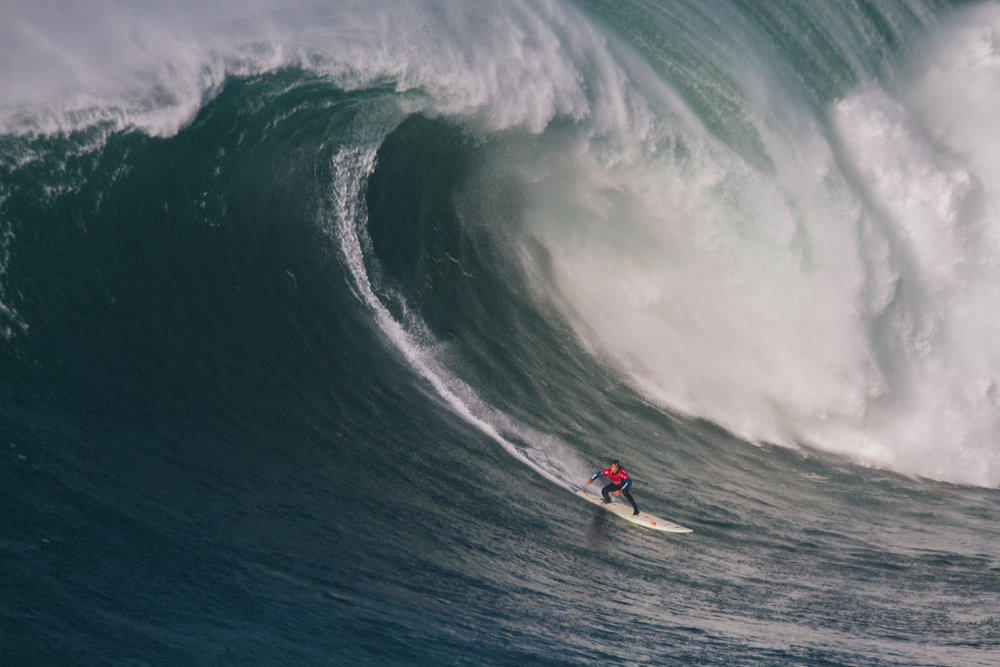 Carlos Burle at Nazaré by Cruz