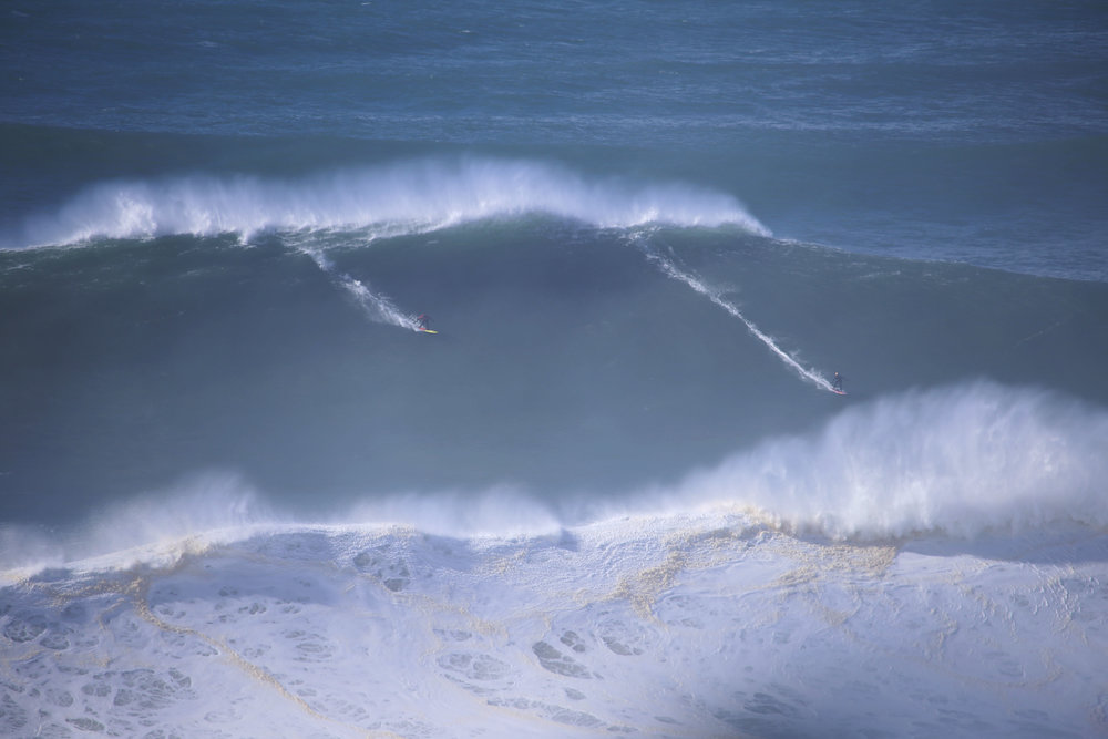 Ross Clarke-Jones and Justine Dupont at Nazaré by Botelho
