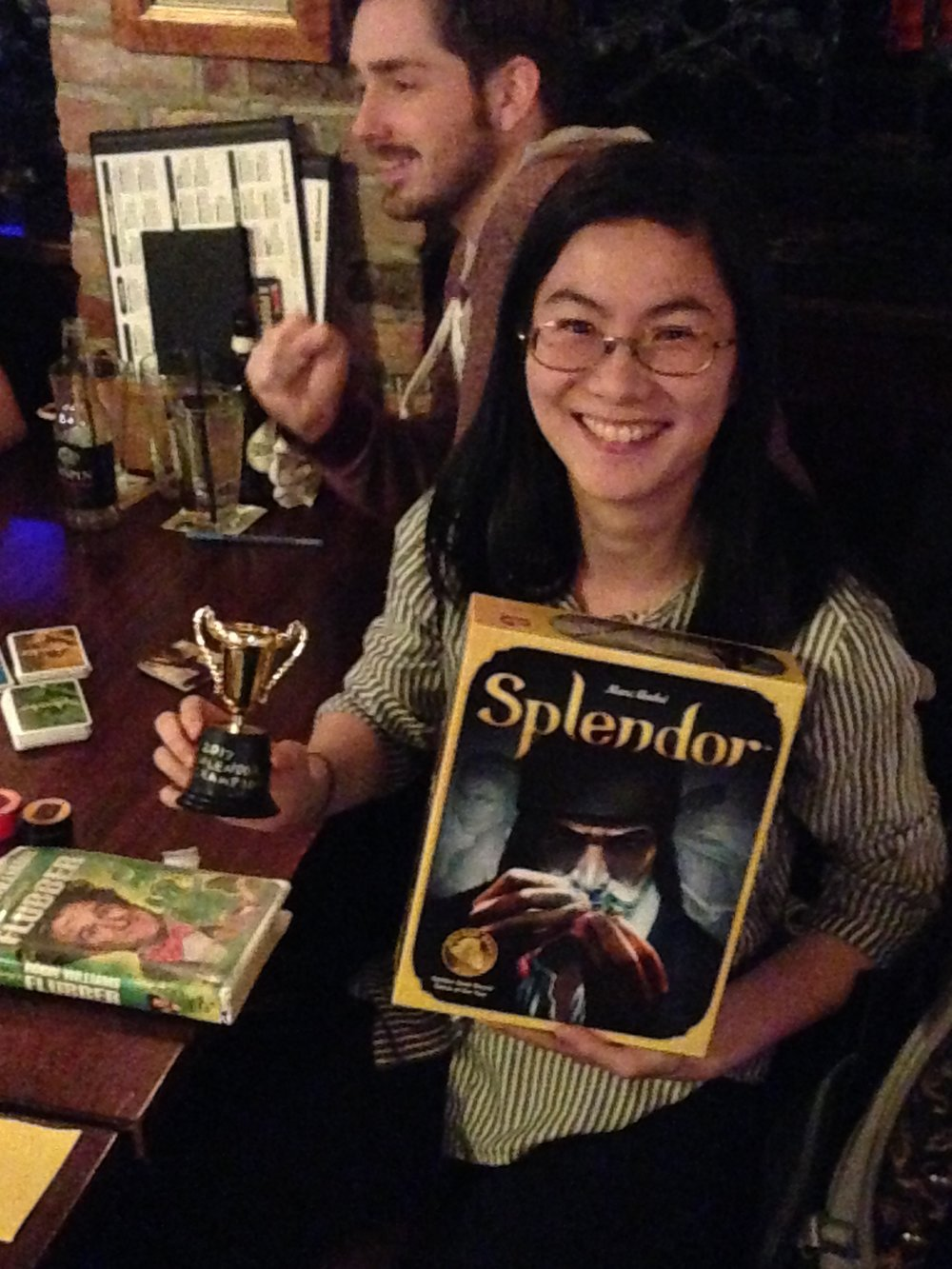 A hearty congratulations to Amy Wen for winning our first tournament of 2017: A two-round Splendor bout that saw her come in first in both games she played. That copy of Flubber on VHS that you see there? Part of the prize for her domination. To the victor go the spoils.