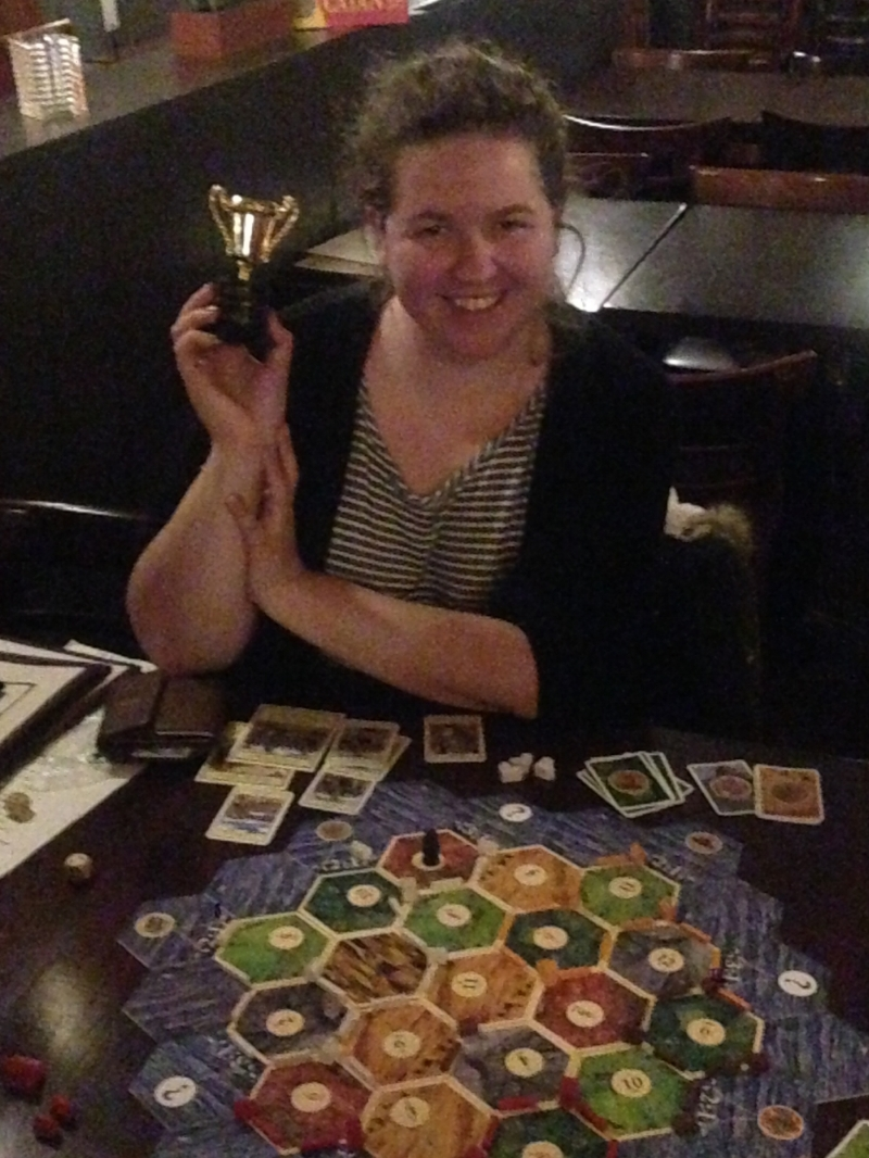 Parker Poche showed up for the first BoardGame Empire tournament at our new digs in Porter Square and quickly staked her claim as champion of all of Catan. She scored back-to-back victories in this multi-round tourney and took home the trophy.