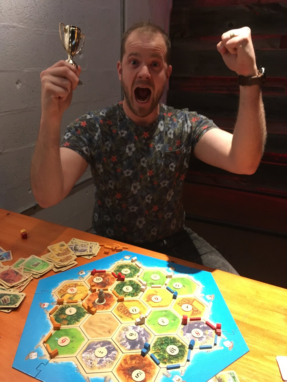 While his opponents were fighting over the largest army, Josh Wilson was staking out his victory. Our 2018 Settlers tourney featured a kid who could solve rubik's cubes in 50 seconds, a heated battle for a wild card entry into the finals that culminated with a barenuckled rock-paper-scissors match and, of course, plenty of sheep. But Josh Wilson won back-to-back games to emerge as our first tournament champion at Down the Road Brewery.
