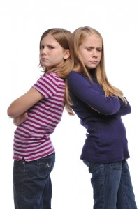 two young girls in a fight