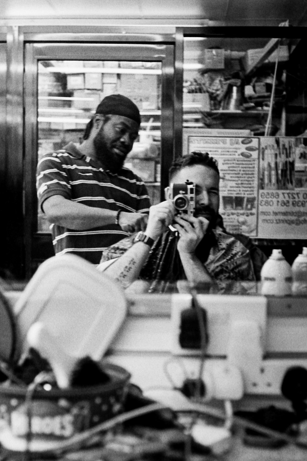 Selfie with barber Mike. Peckham, 2018.