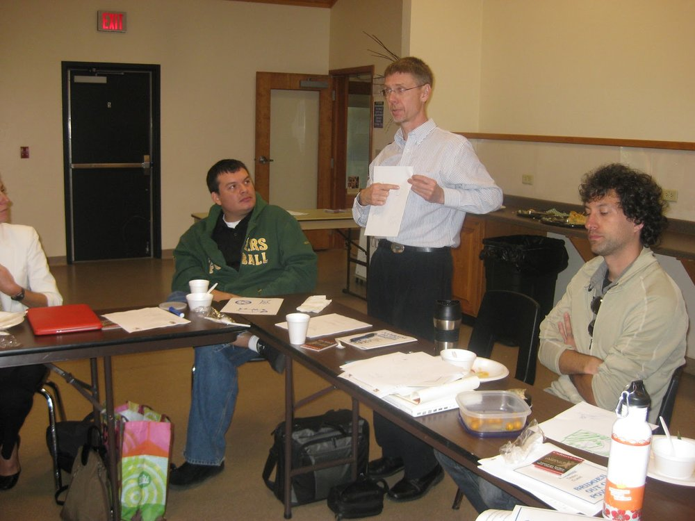 Geof Swain, Medical Director and Chief Medical Officer for the Milwaukee Health Department, as well as Preceptor for Fellows placed in Milwaukee, explains his drawing during an introductory activity in Keshena, Wisconsin