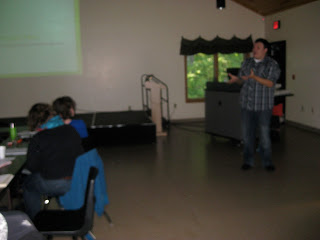 Isaiah Brokenleg shares some of the culture and history of the Menominee tribe with the fellows