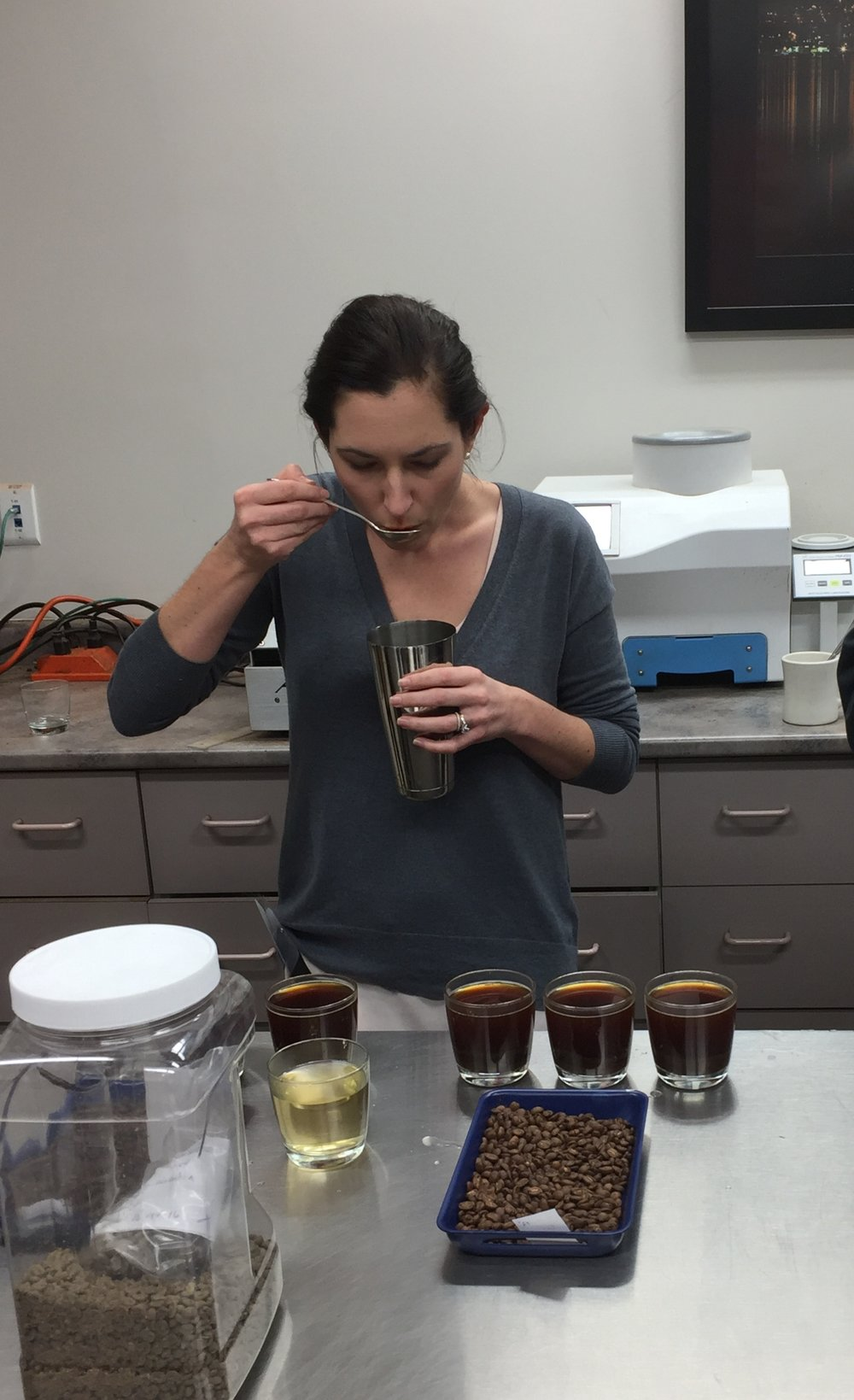 Attie cupping coffees at the Swiss Water cupping lab