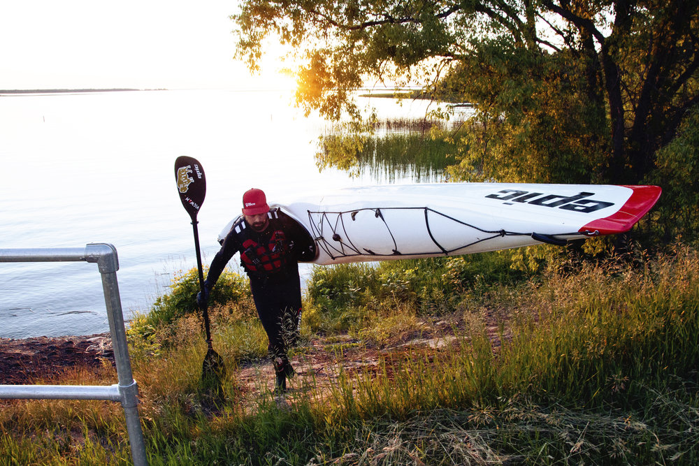 Mike carrying his Epic Kayak out of Lake Winnie on Day 2!