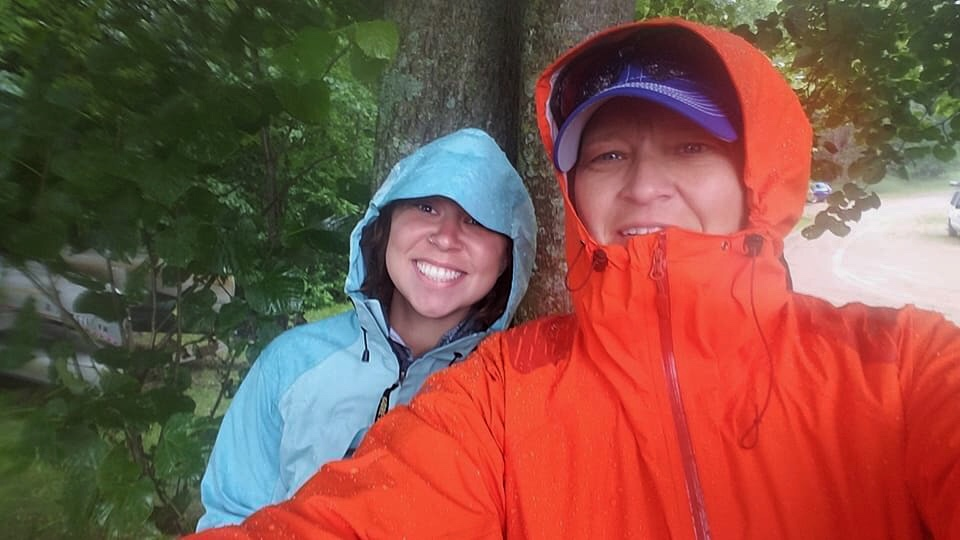 Traci and I waiting in the rain for Mike to pass by! Wanted to check on him during the storms through Brainerd, MN.