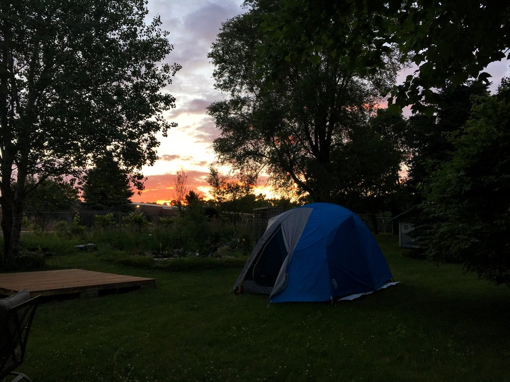 Our tent set up in Becky and Harry's back yard with our own little sunset and pond!