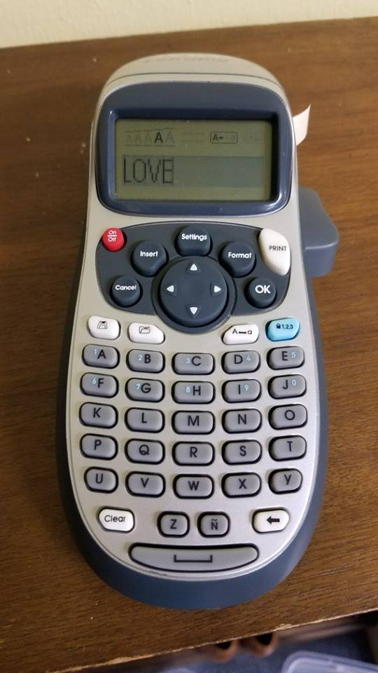 This was the word on the Lottie House label maker when Adam turned it on! Can't make up this stuff!