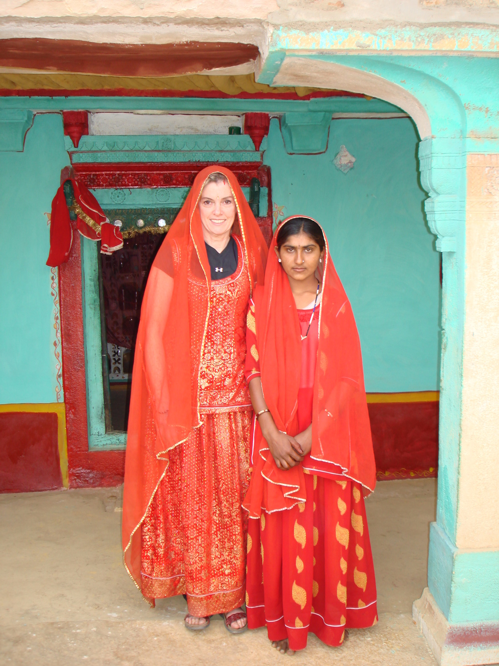 Mary Anthony Realtor India red dress.JPG