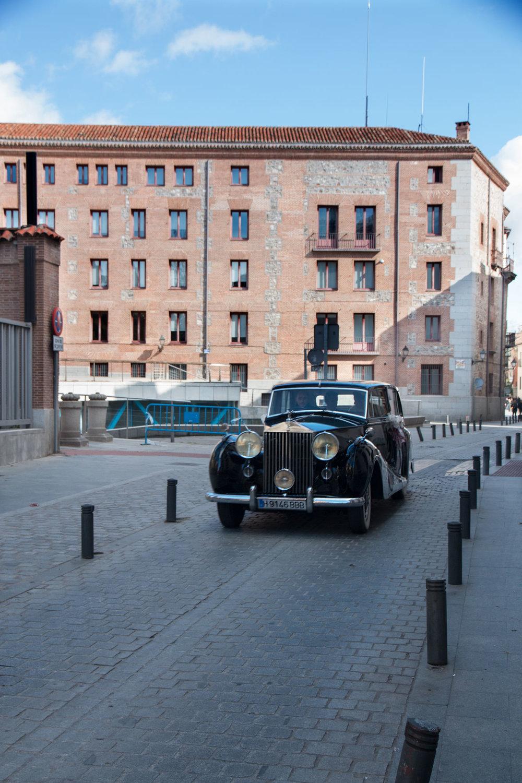 Spanish Bride and Groom in their vintage wedding car.