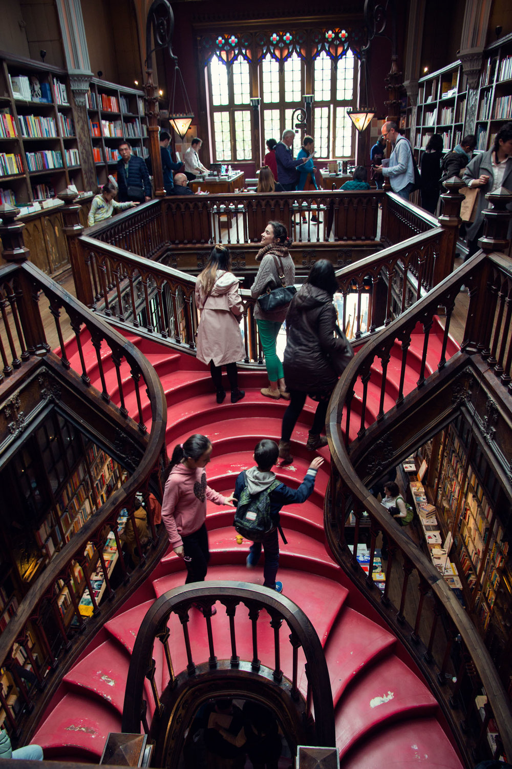 The famous red staircase in Livraria Lello bookstore.