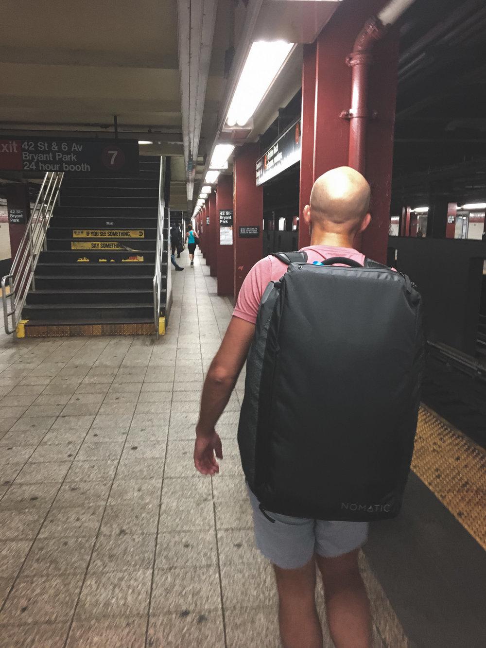 Rocking the Nomatic Travel Bag.