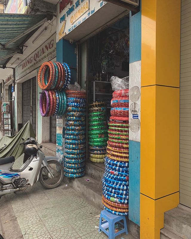 Inner tubes are a big and colourful business in Vietnam. When half of the the 92m people here own a motorbike/scooter you might as well make them nice to look at! . . . . . #huevietnam #hue #vietnamadventures #streetphotography #streetphoto #photoreportage #reportage #igtraveller #traditionaldress #scooterlife #scooterlifestyle