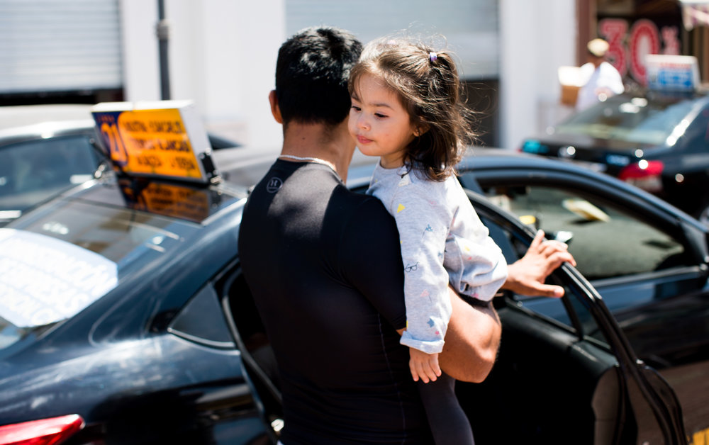 Chile girl and dad getting into car.jpg