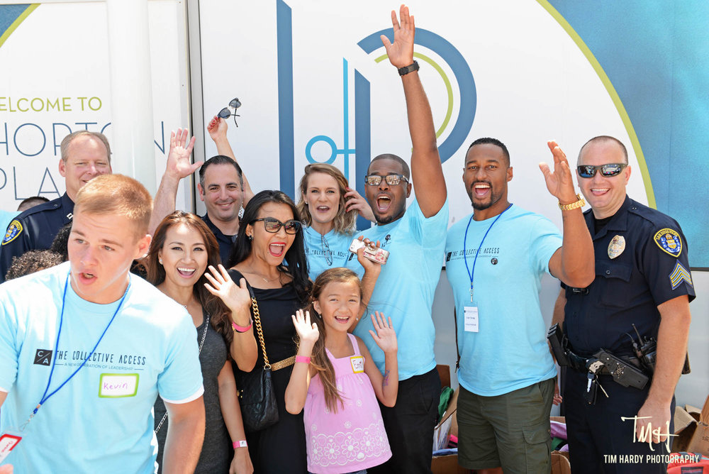 """The Collective Access hosted our fist going back to school event in August 2017. """"Message to the Youth"""" brought together kids, families, local non-profits, law enforcement, first-responders, professional leaders and entrepreneurs. We were able to provide hundreds of backpacks filled with school supplies for San Diego's youth. Just as importantly, we had a host of inspirational speakers (young and old!), a dance-off, the Hoover High School marching band, and a hula-hoop contest! Click the picture and check out the fun and motivation!"""