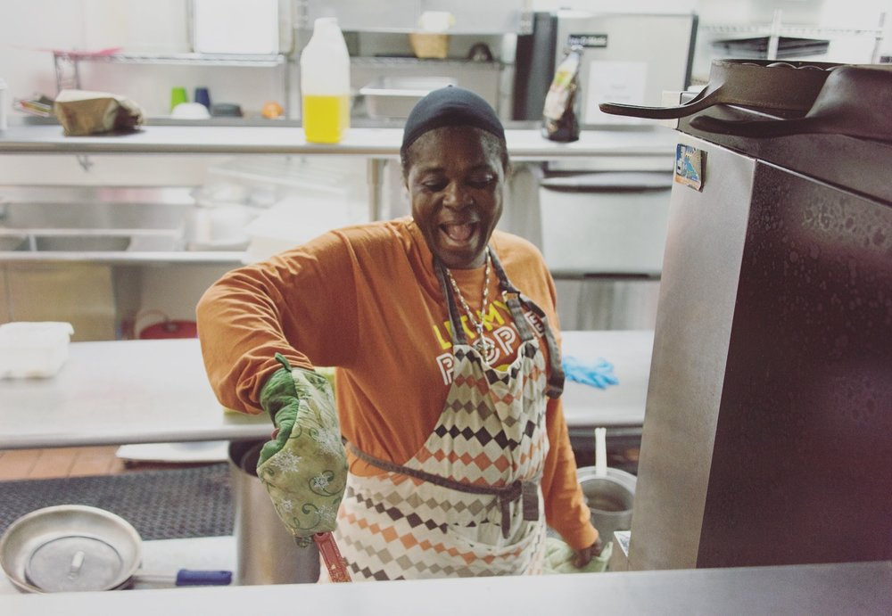 A volunteer at Food Shift's Alameda kitchen happily cooking away some Imperfect produce. Meals like this feed hundreds of people through Josephine and City Team. Photo by Joi Ong.