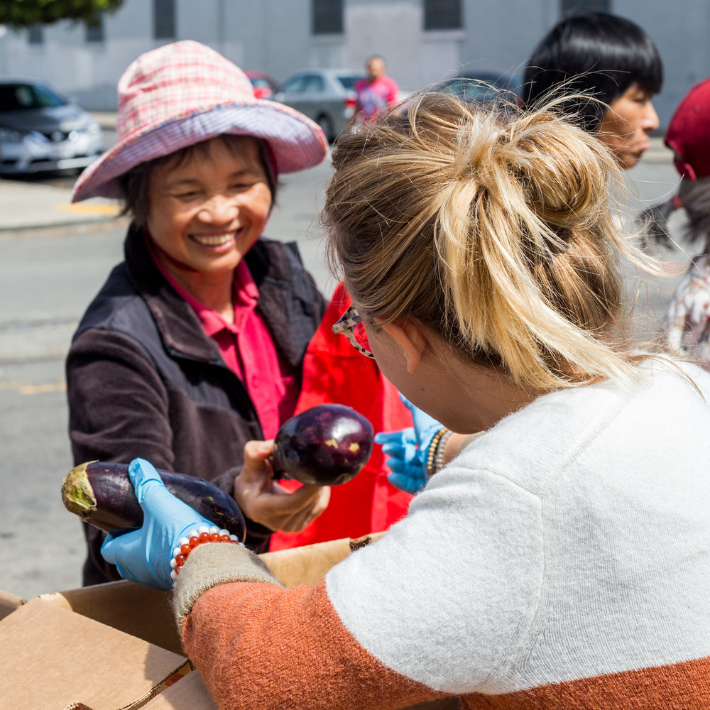 Spreading smiles and eggplant at our free farmers market in the Bayview district of SF