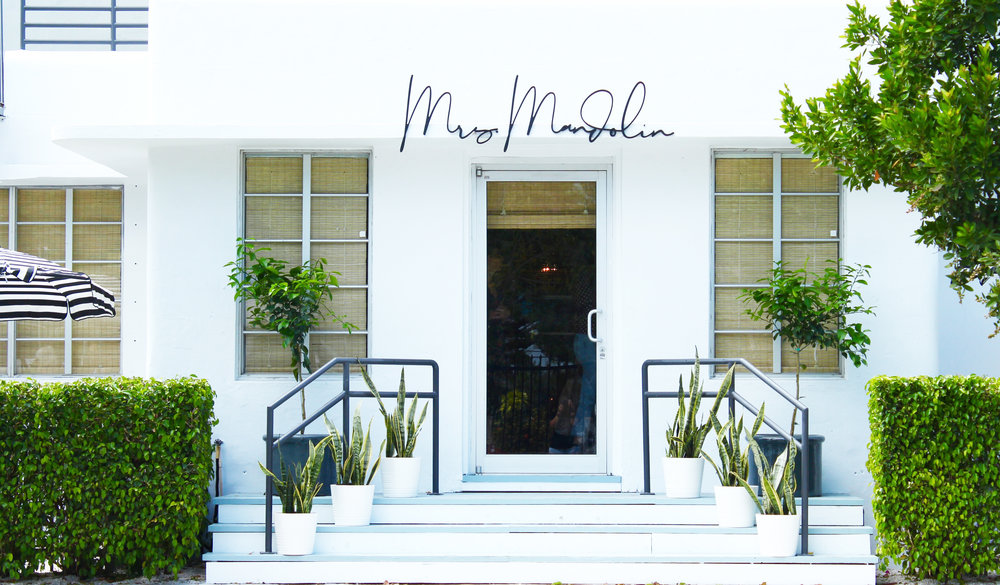 - Mrs. Mandolin,the newest venture from the team behind Miami's beloved restaurant, Mandolin Aegean Bistro, is a café and lifestyle store inspired by travel, culture and the effortless ease of the Mediterranean way of life. The store was founded by Anastasia Koutsioukis, the female force behind Mandolin Aegean bistro. Mrs. Mandolin was the moniker given to Anastasia by her patrons throughout the years. As the perennial host and creative director, she was constantly being asked for tabletop and travel tips, sourcing references in all of the best Mediterranean markets, and her take on fashion and accessory brands that she was coveting. For many years it was her dream to create an extension of Mandolin that felt similar to the way she actually lived her life, she has now brought all to life under one roof with her new lifestyle boutique and cafe located a block away from her restaurant at 4218 NE 2nd Avenue, Miami, FL 33137.