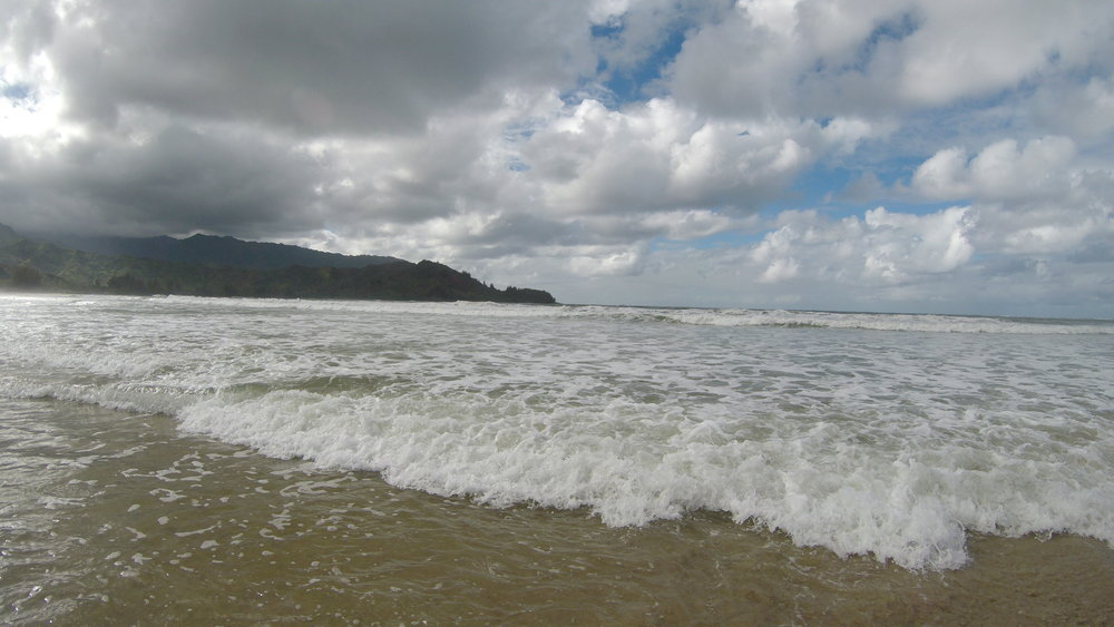 explore hanalei bay - This is a must-visit spot as it is the largest bay on the north shore of the island consisting of two miles of beaches surrounded by mountains. It's a great place for photography and to dip your toes in the ocean.