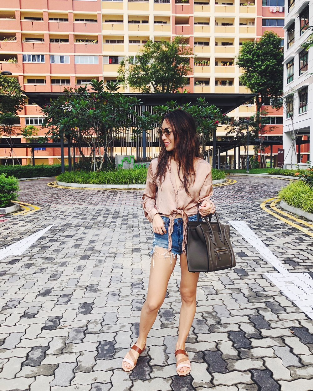 Location: Singapore | Wearing: Aritzia silk blouse, Charles & Keith sandals & sunnies, Nordstrom STS blue denim shorts, Celine micro luggage