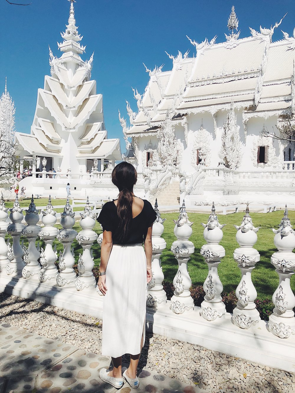 Location: White Temple in Chiang Rai, Thailand | Wearing: Aritzia skirt, Toms shoes, blouse from a local brand