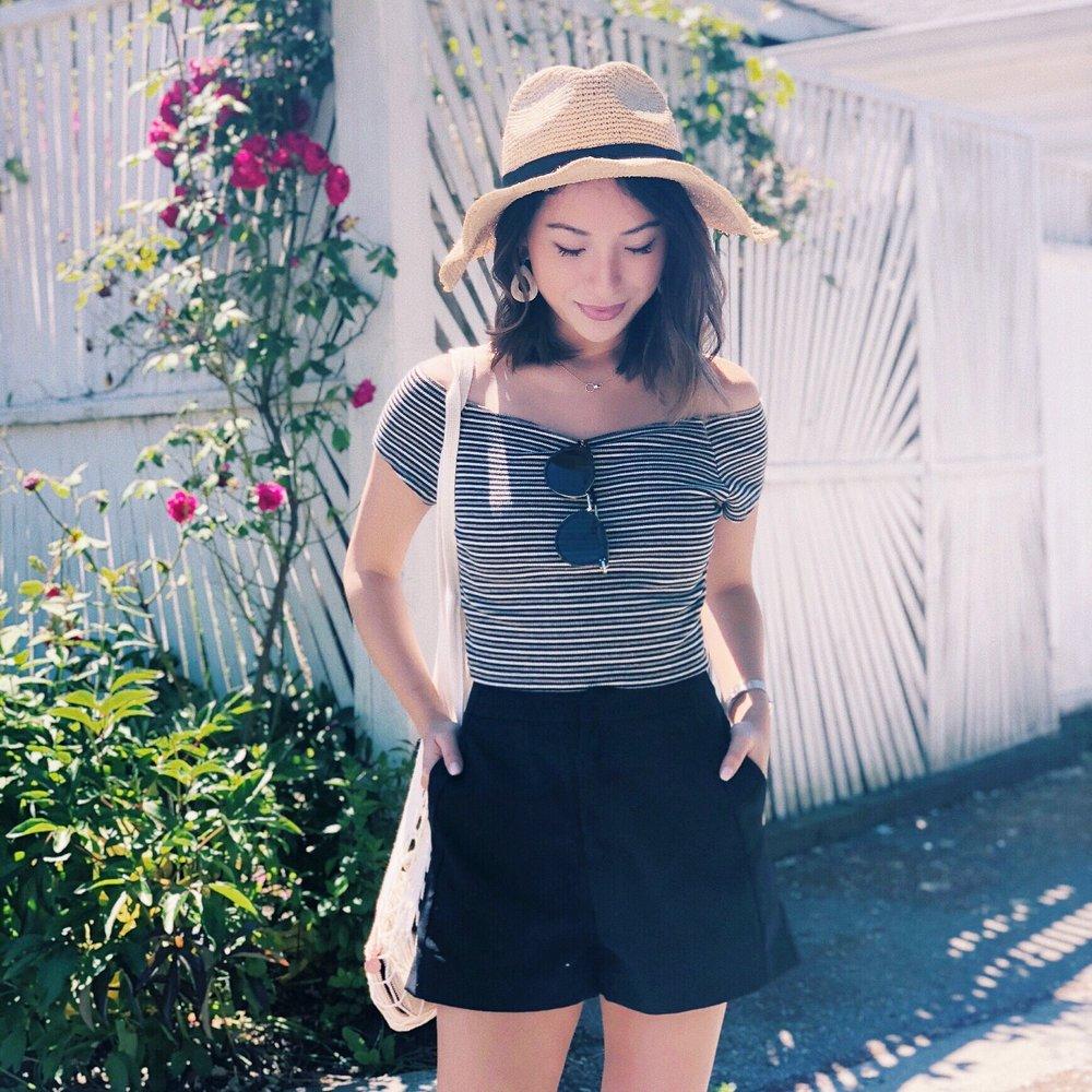 cute + casual - Straw Hat: J. CrewSunnies: CelineShorts: Runway BanditsTop: Brandy MelvilleNet Bag: FiltEarrings: Soko Jewelry