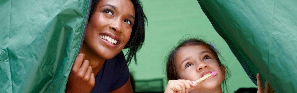 young-mother-and-daughter-inside-tent-in-morning-picture-id462613645.jpg