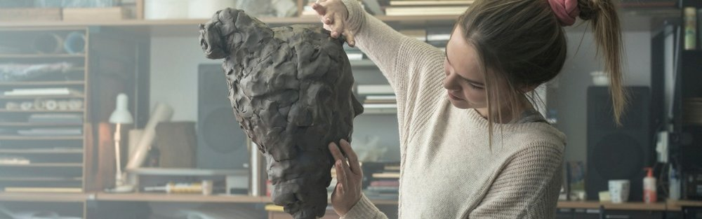 young-sculptor-creates-a-clay-sculpture-picture-id678969546.jpg