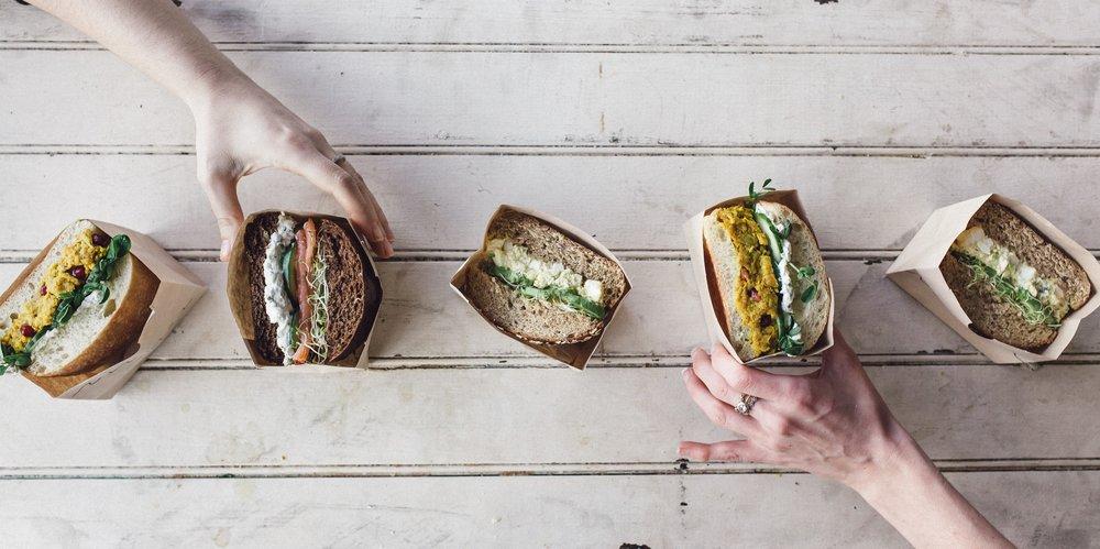 andrea, sophia & egg salad sandwiches overhead with hands 1 (Victoria Morris).jpg