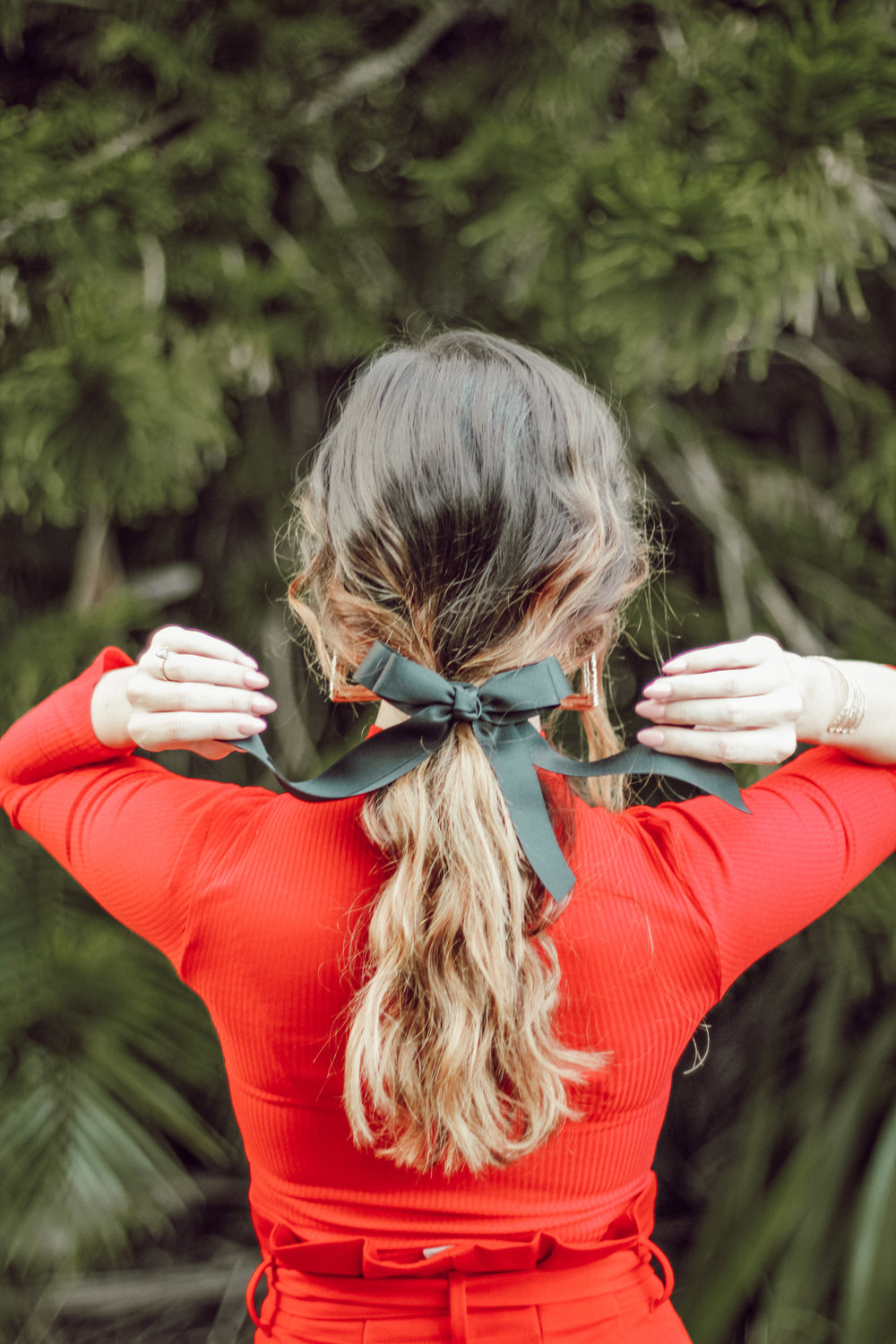 Red Holiday look with black bow hair tie